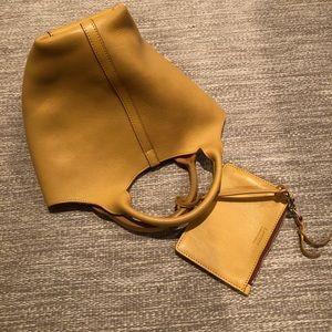 Lotuff leather hand bag